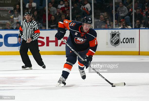 Aaron Johnson of the New York Islanders shoots the puck from center ice during NHL game action against the Anaheim Ducks on February 5 2008 at the...