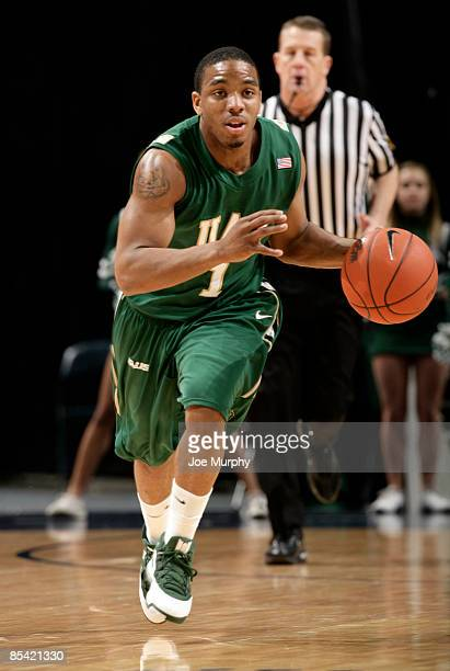 Aaron Johnson of the UAB Blazers brings the ball upcourt against the Tulsa Golden Hurricane during the Semifinals of the Conference USA Basketball...