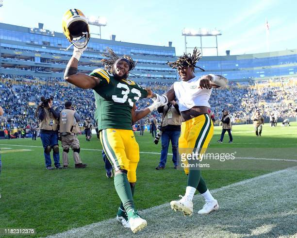 Aaron Jones of the Green Bay Packers and Jamaal Williams of the Green Bay Packers celebrate after the game against the Oakland Raiders at Lambeau...