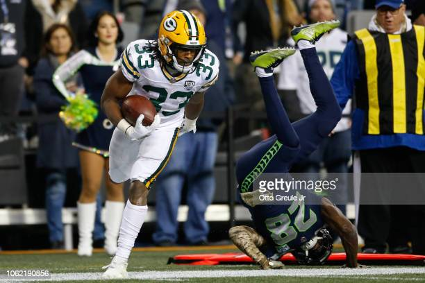 Aaron Jones of the Green Bay Packers catches the ball against Justin Coleman of the Seattle Seahawks in the second half at CenturyLink Field on...