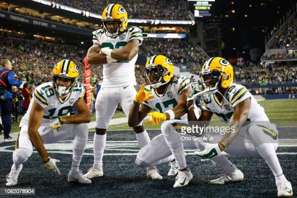 Aaron Jones of the Green Bay Packers celebrate a touchdown during the first quarter against the Seattle Seahawks at CenturyLink Field on November 15...