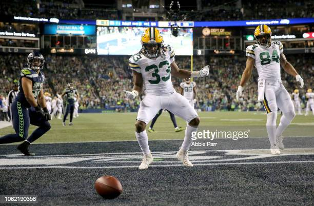 Aaron Jones of the Green Bay Packers celebrates a second quarter touchdown against the Seattle Seahawks at CenturyLink Field on November 15 2018 in...