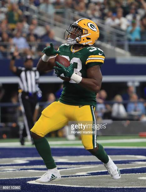 Aaron Jones of the Green Bay Packers celebrates a touchdown in the second quarter against the Dallas Cowboys at ATT Stadium on October 8 2017 in...