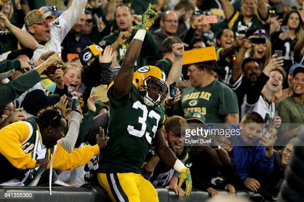 Aaron Jones of the Green Bay Packers celebrates after scoring a touchdown in the second quarter against the Los Angeles Rams during a preseason game...