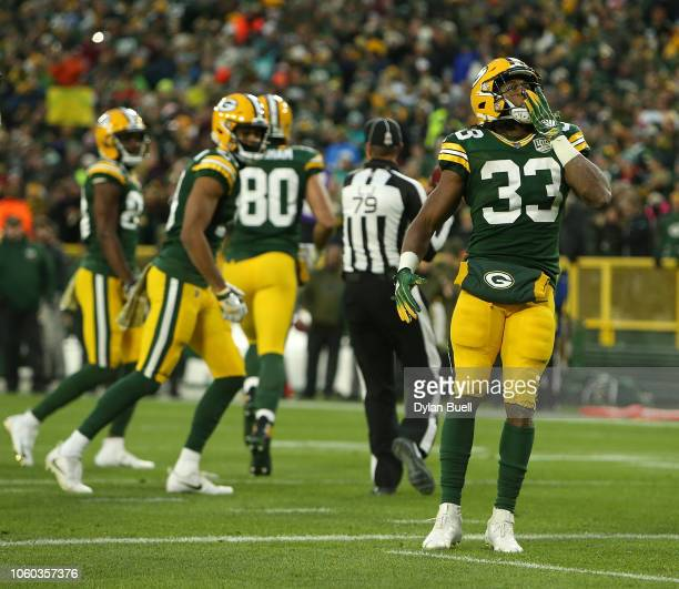 Aaron Jones of the Green Bay Packers celebrates after scoring a touchdown during the first half of a game against the Miami Dolphins at Lambeau Field...