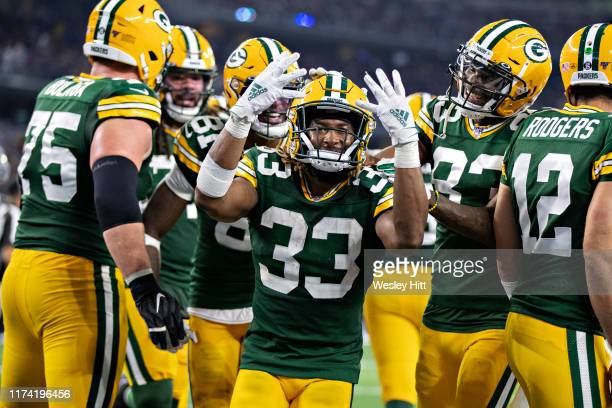 Aaron Jones of the Green Bay Packers celebrates after scoring his fourth touchdown during a game against the Dallas Cowboys at ATT Stadium on October...