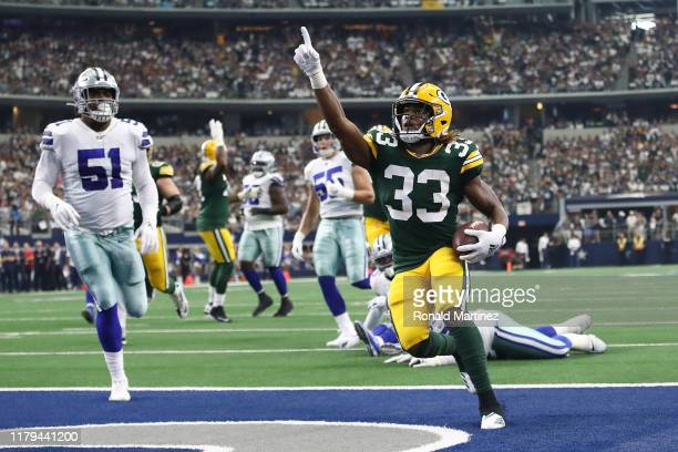 Aaron Jones of the Green Bay Packers celebrates after scoring on an 18yard run against the Dallas Cowboys in the first quarter of their game at ATT...