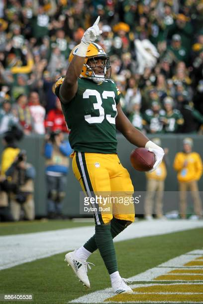 Aaron Jones of the Green Bay Packers celebrates after scoring the game winning touchdown to beat the Tampa Bay Buccaneers 2620 at Lambeau Field on...