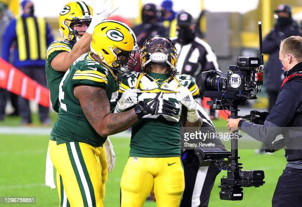 Aaron Jones of the Green Bay Packers celebrates scoring a touchdown in the third quarter against the Los Angeles Rams during the NFC Divisional...