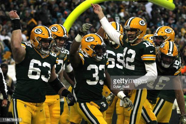 Aaron Jones of the Green Bay Packers celebrates with his teammates after scoring a 5 yard touchdown against the Carolina Panthers during the first...