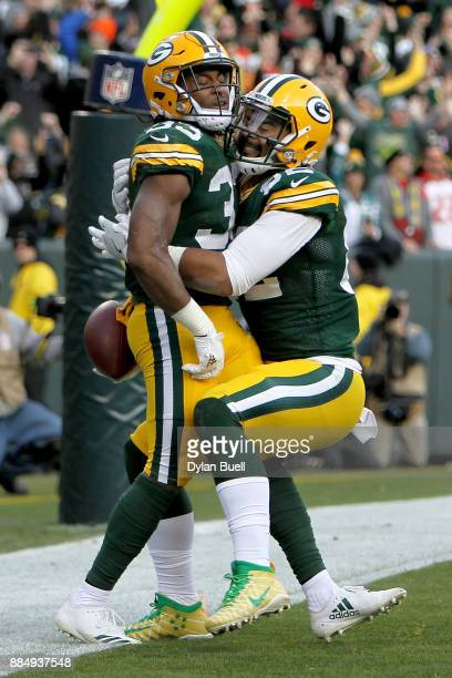 Aaron Jones of the Green Bay Packers celebrates with Richard Rodgers after scoring a touchdown to beat the Tampa Bay Buccaneers 2620 in overtime at...