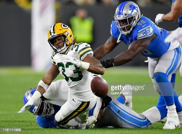 Aaron Jones of the Green Bay Packers fumbles the football in the first quarter against the Detroit Lions at Lambeau Field on October 14 2019 in Green...