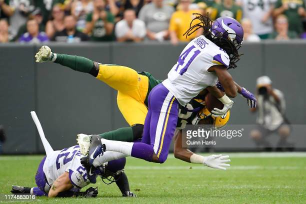 Aaron Jones of the Green Bay Packers is tackled in the fourth quarter by Anthony Harris of the Minnesota Vikings at Lambeau Field on September 15...