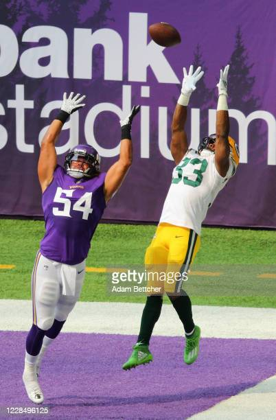 Aaron Jones of the Green Bay Packers pulls in a pass out of bounds against Eric Kendricks of the Minnesota Vikings in the first quarter at U.S. Bank...