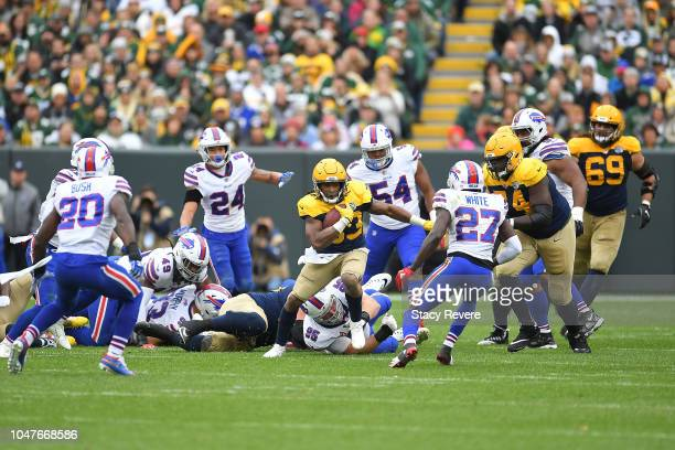 Aaron Jones of the Green Bay Packers runs for yards during a game against the Buffalo Bills at Lambeau Field on September 30 2018 in Green Bay...
