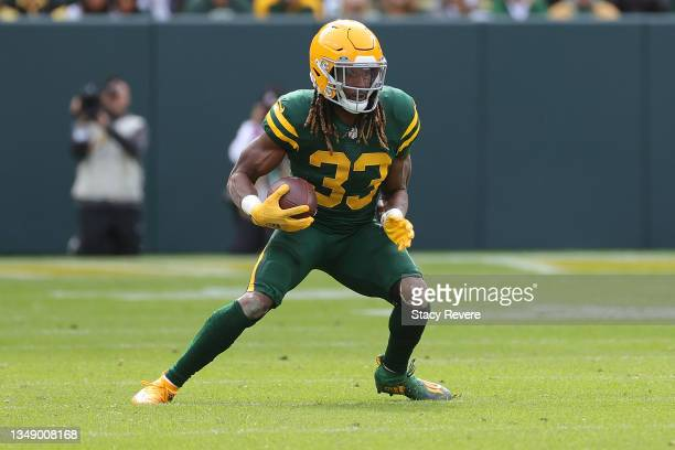 Aaron Jones of the Green Bay Packers runs for yards during a game against the Washington Football Team at Lambeau Field on October 24, 2021 in Green...