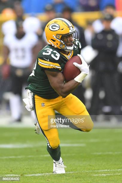 Aaron Jones of the Green Bay Packers runs for yards during a game against the New Orleans Saints at Lambeau Field on October 22 2017 in Green Bay...