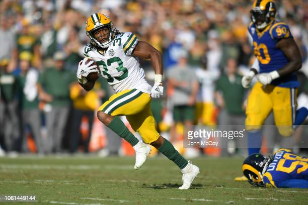 Aaron Jones of the Green Bay Packers runs past Los Angeles Rams for a touchdown at Los Angeles Memorial Coliseum on October 28 2018 in Los Angeles...