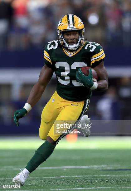 Aaron Jones of the Green Bay Packers runs the ball against the Dallas Cowboys in the fourth quarter at ATT Stadium on October 8 2017 in Arlington...