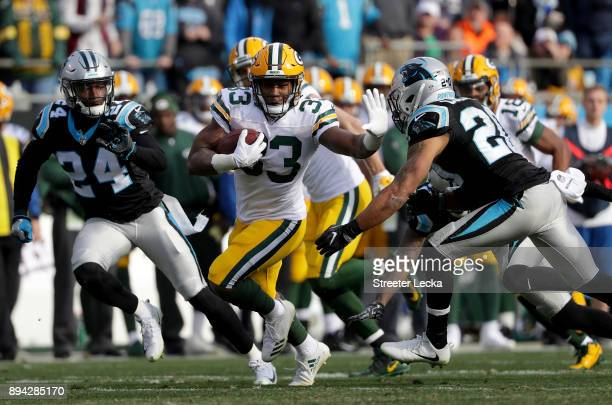 Aaron Jones of the Green Bay Packers runs the ball against the Carolina Panthers in the second quarter during their game at Bank of America Stadium...