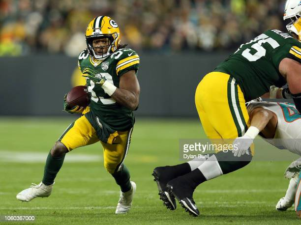 Aaron Jones of the Green Bay Packers runs the ball during the second half of a game against the Miami Dolphins at Lambeau Field on November 11 2018...