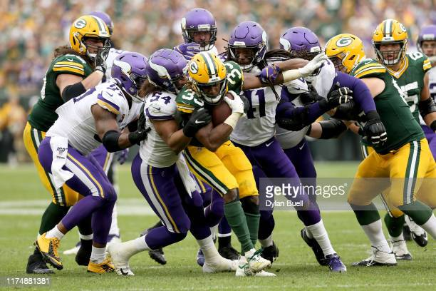 Aaron Jones of the Green Bay Packers runs with the ball against Eric Kendricks of the Minnesota Vikings in the fourth quarter at Lambeau Field on...