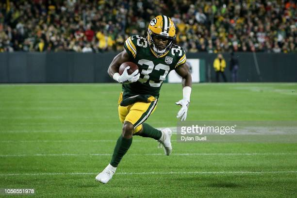 Aaron Jones of the Green Bay Packers runs with the ball in the first quarter against the San Francisco 49ers at Lambeau Field on October 15 2018 in...
