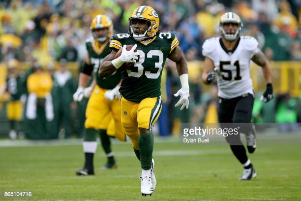 Aaron Jones of the Green Bay Packers runs with the ball in the first quarter against the New Orleans Saints at Lambeau Field on October 22 2017 in...