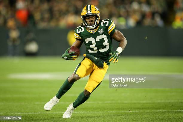 Aaron Jones of the Green Bay Packers runs with the ball in the third quarter against the Miami Dolphins at Lambeau Field on November 11 2018 in Green...
