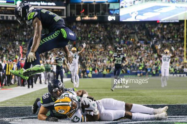 Aaron Jones of the Green Bay Packers scores a touchdown against Austin Calitro of the Seattle Seahawks in the second quarter at CenturyLink Field on...