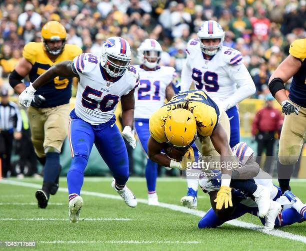 Aaron Jones of the Green Bay Packers scores a touchdown during the second quarter of a game against the Buffalo Bills at Lambeau Field on September...