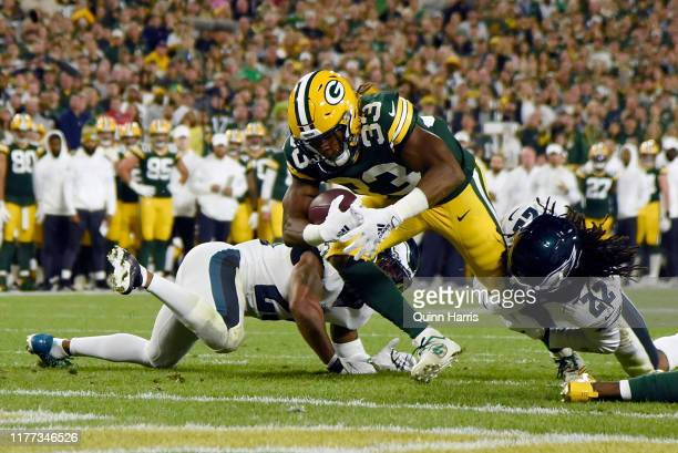 Aaron Jones of the Green Bay Packers scores a touchdown in the first quarter against the Philadelphia Eagles at Lambeau Field on September 26 2019 in...