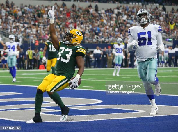 Aaron Jones of the Green Bay Packers scores against the Dallas Cowboys in the first quarter against the Green Bay Packers at ATT Stadium on October...