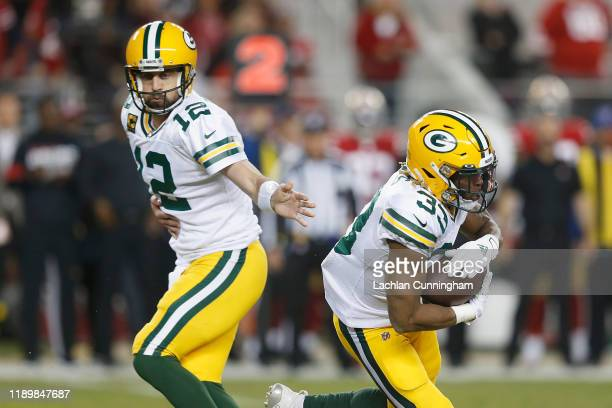 Aaron Jones of the Green Bay Packers takes the hand off from quarterback Aaron Rodgers in the first quarter at Levi's Stadium on November 24 2019 in...