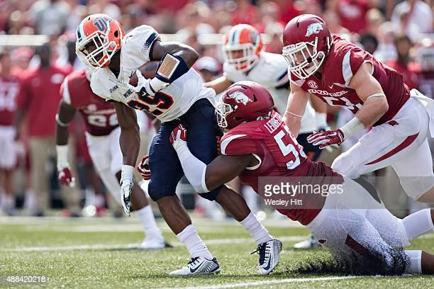 Aaron Jones of the UTEP Miners is tackled by Jeremiah Ledbetter of the Arkansas Razorbacks at Razorback Stadium on September 5 2015 in Fayetteville...
