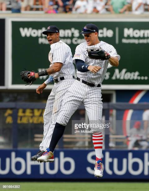 Aaron Judge and Aaron Hicks of the New York Yankees celebrate after defeating the Atlanta Braves at Yankee Stadium on July 4 2018 in the Bronx...