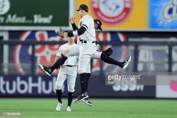 Aaron Judge and Cameron Maybin of the New York Yankees celebrate their 8-2 win over the Minnesota Twins in game two of the American League Division...