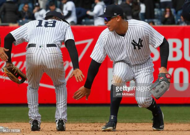 Aaron Judge and Didi Gregorius of the New York Yankees celebrate after defeating the Baltimore Orioles at Yankee Stadium on April 7 2018 in the Bronx...