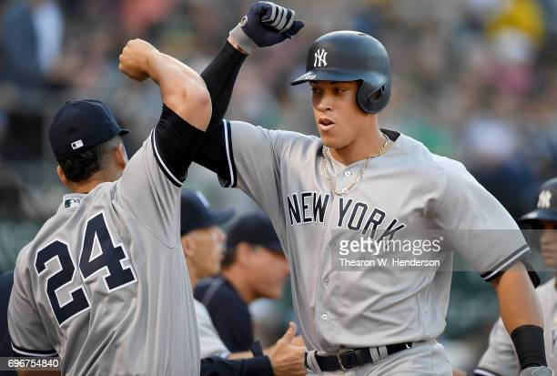 Aaron Judge and Gary Sanchez of the New York Yankees celebrate after Judge hit a threerun homer against the Oakland Athletics in the top of the third...