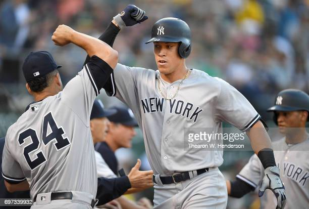 Aaron Judge and Gary Sanchez of the New York Yankees celebrates after Judge hit a threerun homer against the Oakland Athletics in the top of the...