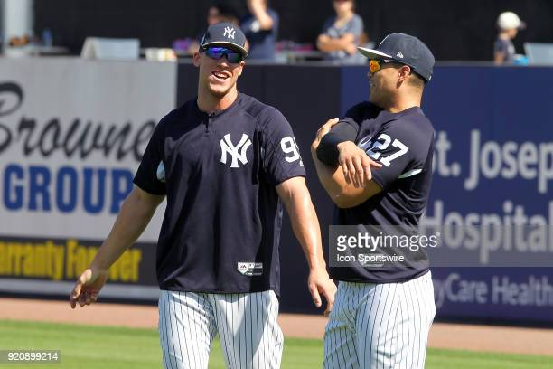 Aaron Judge and Giancarlo Stanton catch up as they stretch during the New York Yankees spring training workout on February 19 at George M...