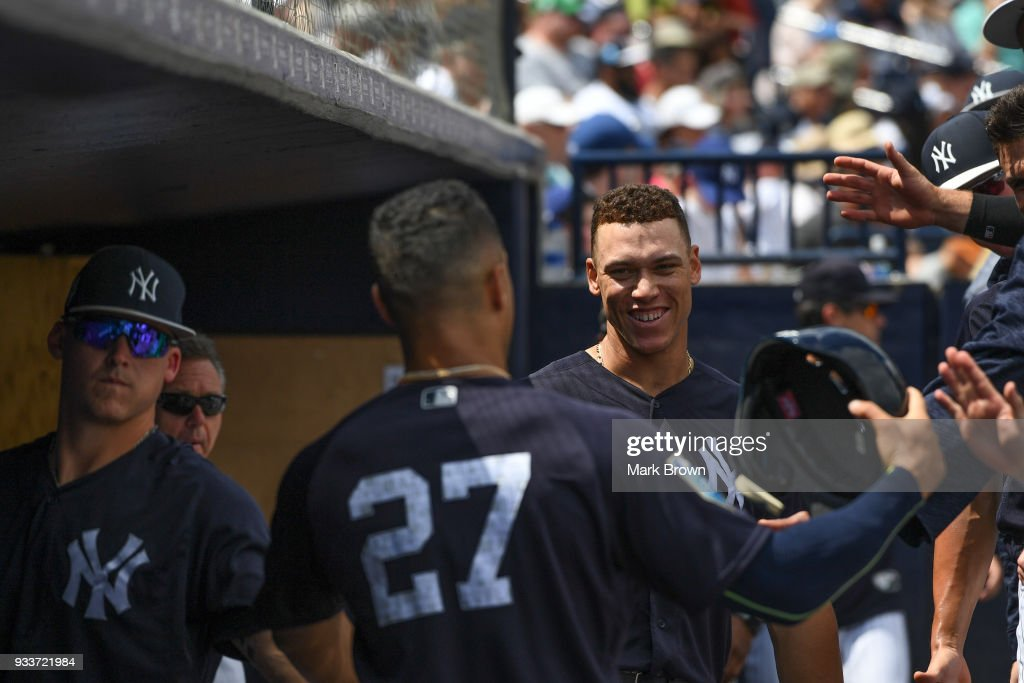 Aaron Judge #99 and Giancarlo Stanton #27 of the New York Yankees during the spring training game between the New York Yankees and the Miami Marlins at George M. Steinbrenner Field on March 18, 2018 in Tampa, Florida.