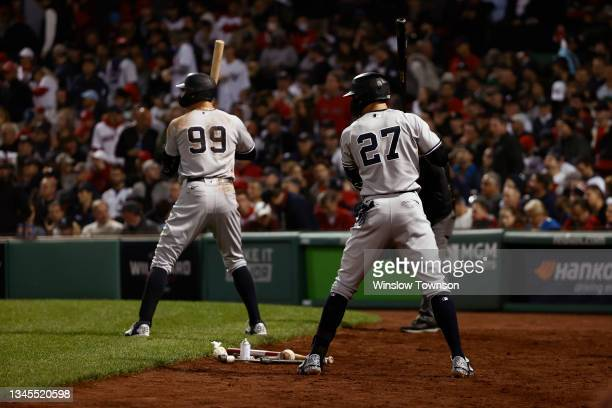 Aaron Judge and Giancarlo Stanton of the New York Yankees on deck during the AL Wild Card playoff game against the Boston Red Sox at Fenway Park on...