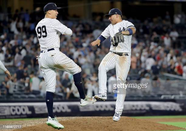 Aaron Judge and Gleyber Torres of the New York Yankees celebrate the 64 win over the Boston Red Sox during game two of a double header at Yankee...