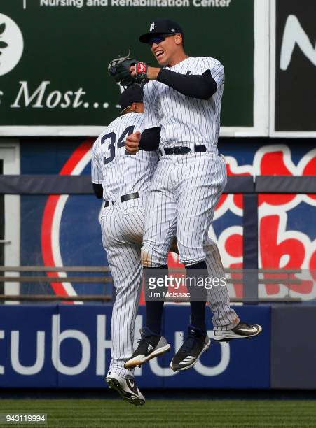 Aaron Judge and Jace Peterson of the New York Yankees celebrate after defeating the Baltimore Orioles at Yankee Stadium on April 7 2018 in the Bronx...