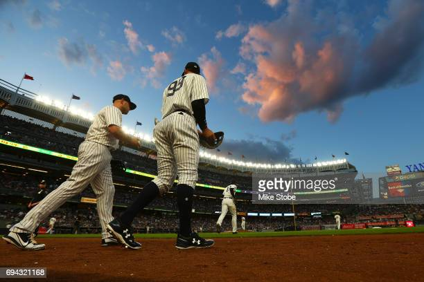 Aaron Judge and Matt Holliday of the New York Yankees take the field for the start of the second inning against the Baltimore Orioles at Yankee...