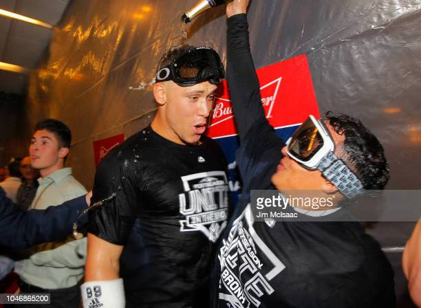 Aaron Judge and Ronald Torreyes of the New York Yankees celebrate in the club house after defeating the Oakland Athletics in the American League Wild...