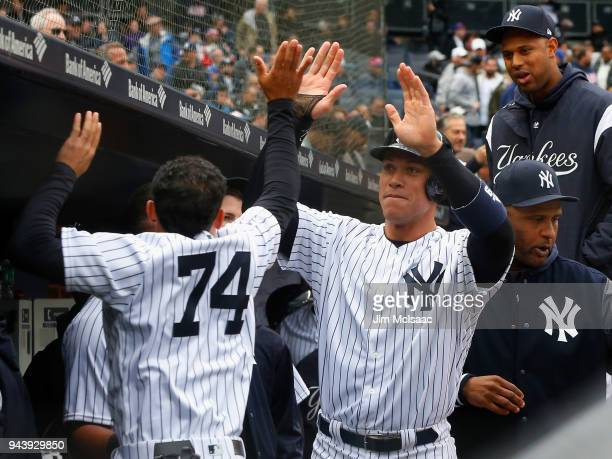 Aaron Judge and Ronald Torreyes of the New York Yankees celebrate against the Tampa Bay Rays at Yankee Stadium on April 4 2018 in the Bronx borough...