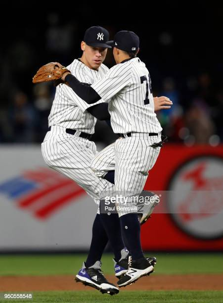 Aaron Judge and Ronald Torreyes of the New York Yankees celebrate the win after the last out of an MLB baseball game against the Toronto Blue Jays on...