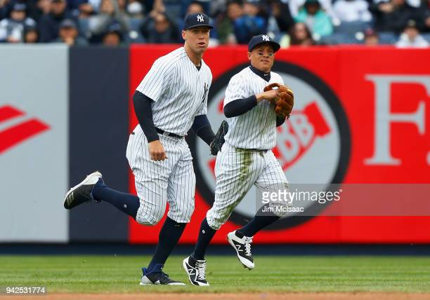 Aaron Judge and Ronald Torreyes of the New York Yankees in action against the Tampa Bay Rays at Yankee Stadium on April 4 2018 in the Bronx borough...